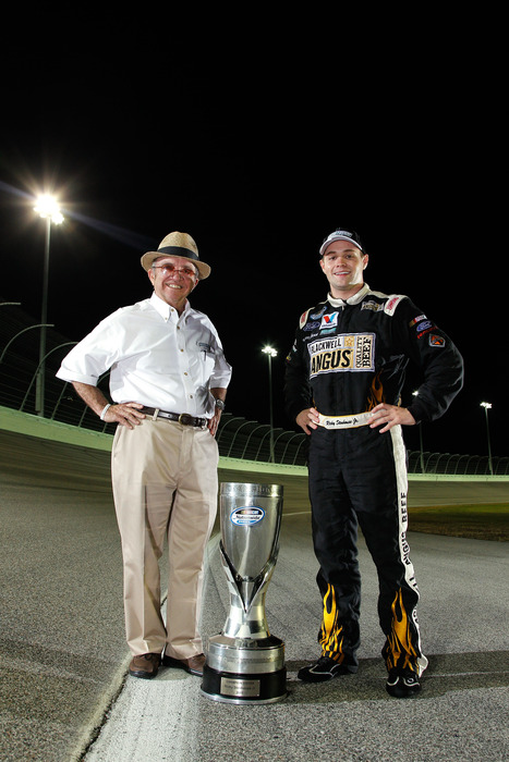 Team co-owner Jack Roush (left) and Ricky Stenhouse Jr. pose with the championship trophy after winning the 2011 NASCAR Nationwide Series Championship in the Ford 300 at Homestead-Miami Speedway.