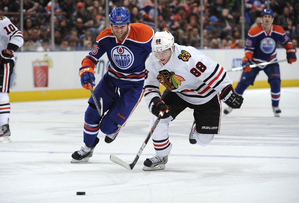 EDMONTON, CANADA - NOVEMBER 19: Ben Eager #55 of the Edmonton Oilers chases Patrick Kane #88 of the Chicago Blackhawks in second period action on November 19, 2011 at Rexall Place in Edmonton, Alberta, Canada. (Photo by Dale MacMillan/Getty Images)
