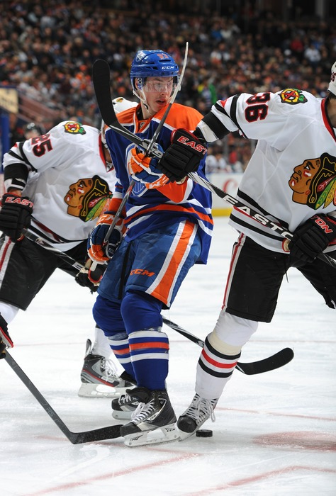 EDMONTON, CANADA - NOVEMBER 19:  Ryan Nugent-Hopkins #93 of the Edmonton Oilers takes a face-off against the Chicago Blackhawks on November 19, 2011 at Rexall Place in Edmonton, Alberta, Canada. (Photo by Dale MacMillan/Getty Images)