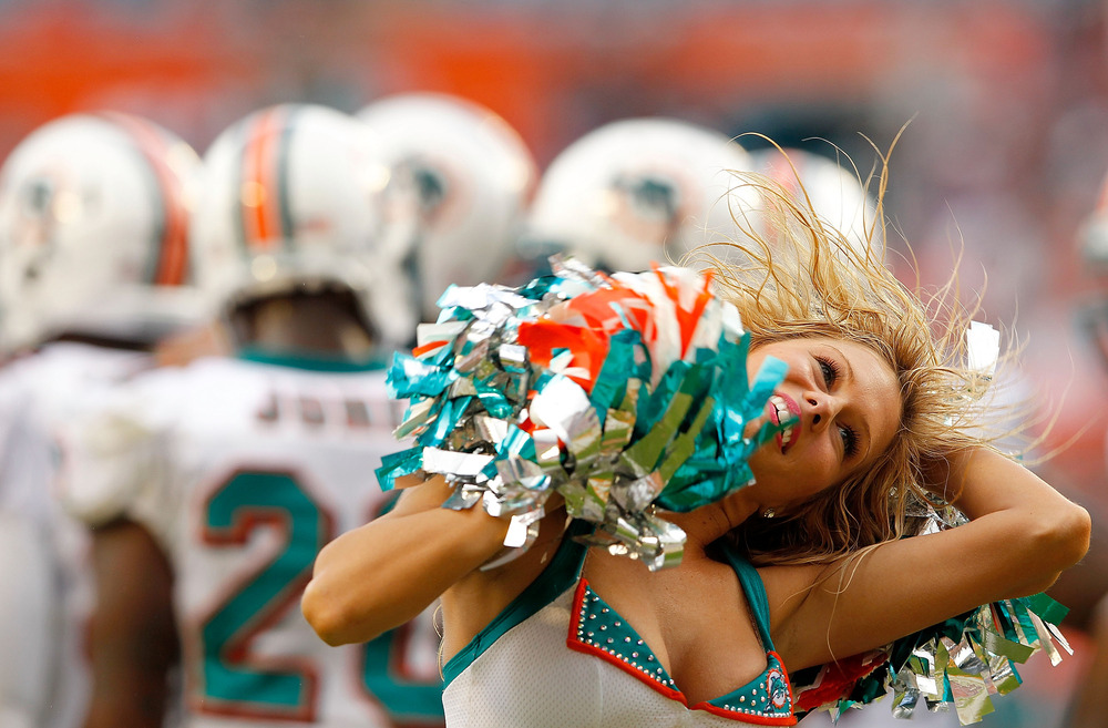 MIAMI GARDENS, FL - NOVEMBER 20:  A Miami Dolphins cheerleader dances during a game against the Buffalo Bills at Sun Life Stadium on November 20, 2011 in Miami Gardens, Florida.  (Photo by Mike Ehrmann/Getty Images)