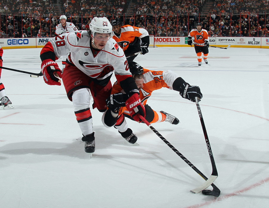 All-star center and Canes-killer Claude Giroux  gets knocked off his skates as he pursues the puck by rookie Defenseman Justin Faulk, who was playing in just his 6th NHL game.