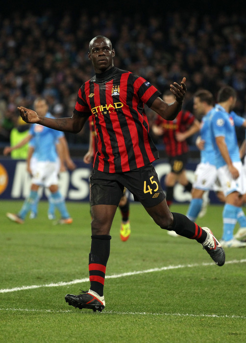 Mario Balotelli of Manchester City celebrates after scoreing during the Uefa Champions League Group A match between Napoli and Manchester City at Stadio San Paolo in Naples, Italy.  (Photo by Clive Rose/Getty Images)
