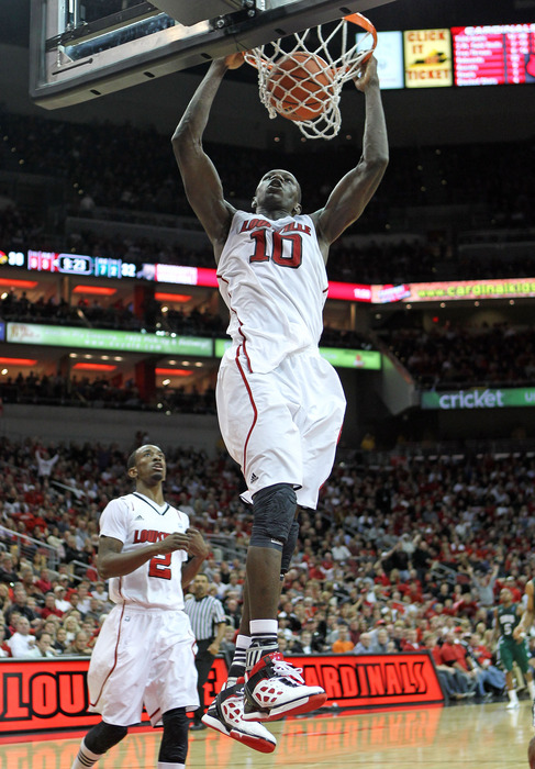 LOUISVILLE, KY - NOVEMBER 25:  Gorgui Deng #10  of the Louisville Cardinals dunks the ball during the game against the Ohio Bobcats at KFC YUM! Center on November 25, 2011 in Louisville, Kentucky.  (Photo by Andy Lyons/Getty Images)