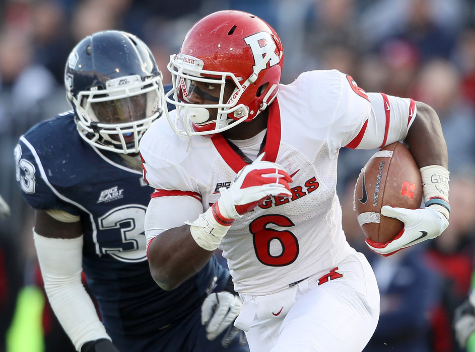 Mohamed Sanu of the Rutgers Scarlet Knights carries the ball against Connecticut. How early will Sanu be taken in the 2012 NFL Draft?  (Photo by Elsa/Getty Images)