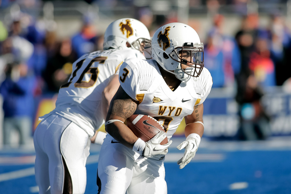BOISE, ID - NOVEMBER 26: Kody Sutton #3 of the Wyoming Cowboys runs the ball against the Boise State Broncos at Bronco Stadium on November 26, 2011 in Boise, Idaho.  (Photo by Otto Kitsinger III/Getty Images)