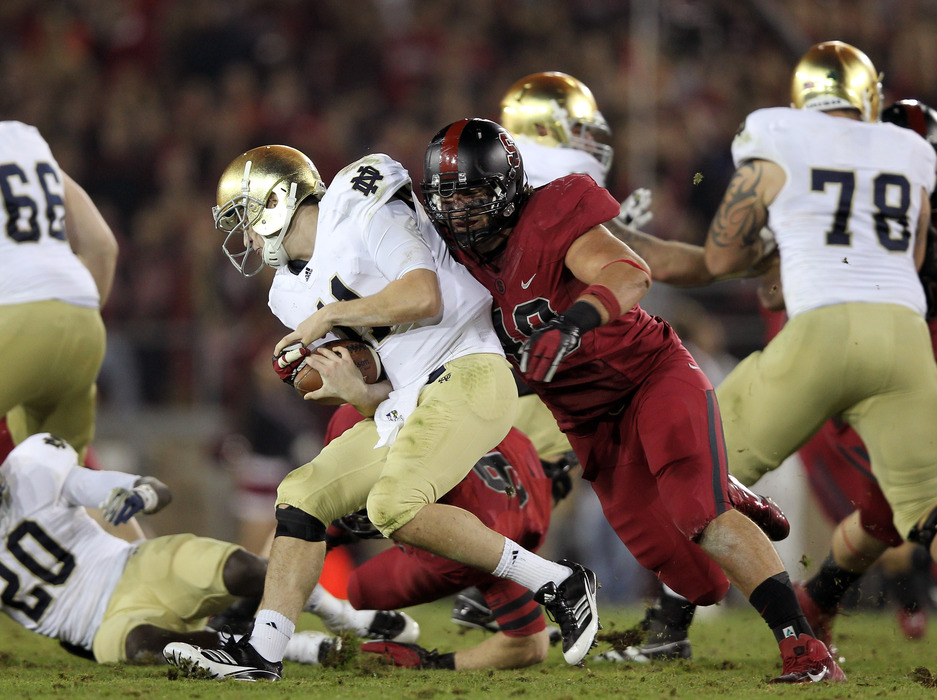 STANFORD, CA - NOVEMBER 26:  Ben Gardner #49 of the Stanford Cardinal sacks Tommy Rees #11 of the Notre Dame Fighting Irish at Stanford Stadium on November 26, 2011 in Stanford, California.  (Photo by Ezra Shaw/Getty Images)