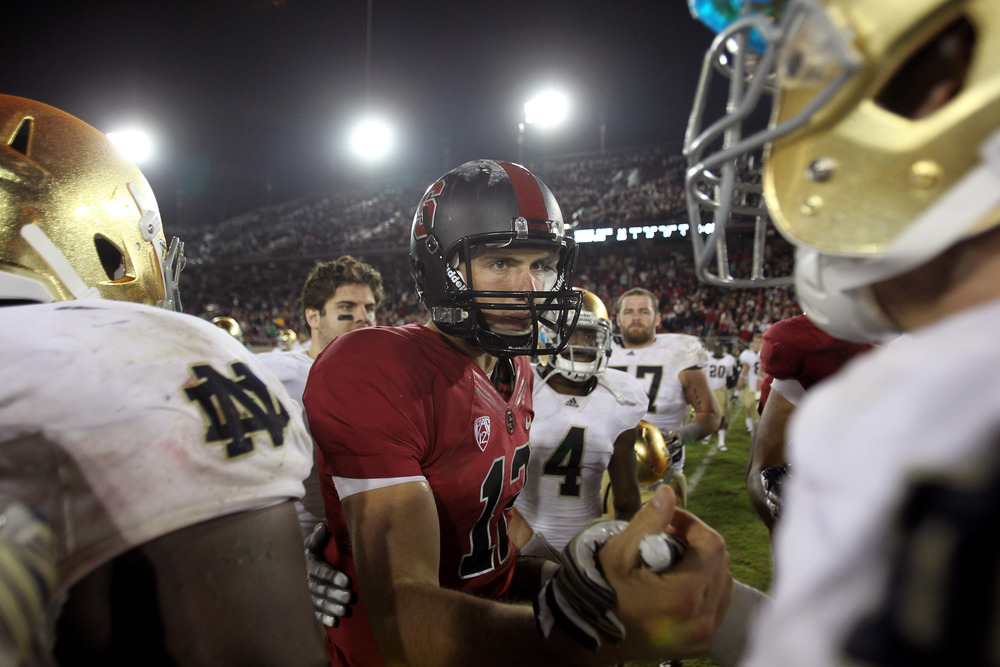 STANFORD, CA - NOVEMBER 26:  Andrew Luck #12 of the Stanford Cardinal shakes hands with players from the Notre Dame Fighting Irish after their game at Stanford Stadium on November 26, 2011 in Stanford, California.  (Photo by Ezra Shaw/Getty Images)