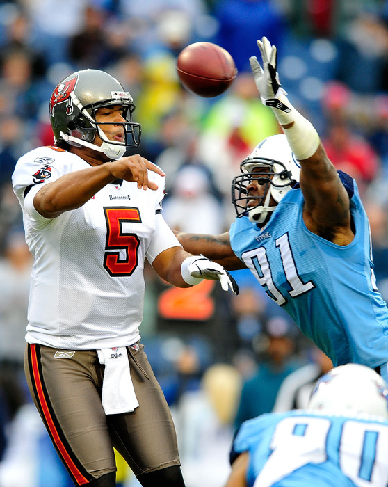 NASHVILLE, TN - NOVEMBER 27:  Jason Jones #91 of the Tennessee Titans pressures quarterback Josh Freeman #5 of the Tampa Bay Buccaneers during play at LP Field on November 27, 2011 in Nashville, Tennessee.  (Photo by Grant Halverson/Getty Images)