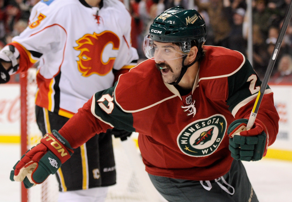 ST PAUL, MN - NOVEMBER 27: Cal Clutterbuck #22 of the Minnesota Wild celebrates a goal against the Calgary Flames in the first period on November 27, 2011 at Xcel Energy Center in St Paul, Minnesota. (Photo by Hannah Foslien/Getty Images)