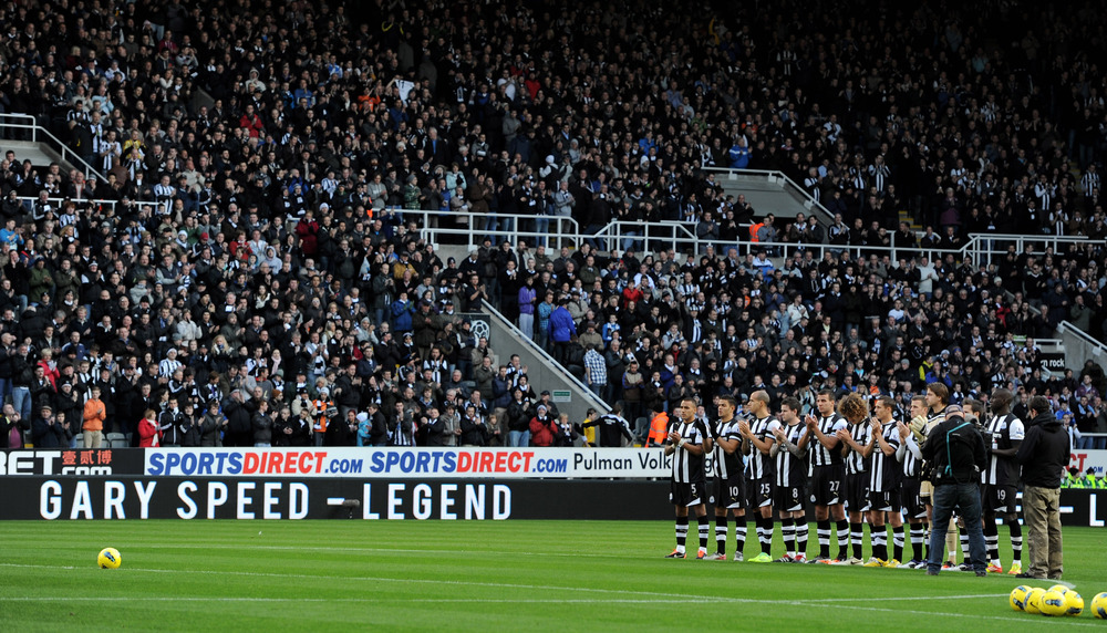 The Newcastle United players and fans acknowledge a minutes applause in honour of the late Gary Speed prior to the Barclays Premier League match between Newcastle United and Chelsea at the Sports Direct Arena.