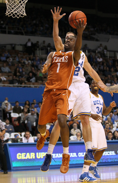 LOS ANGELES, CA - DECEMBER 03:  Sheldon McClellan #1 of the Texas Longhorns shoots over David Wear #12 of the UCLA Bruins at LA Sports Arena on December 3, 2011 in Los Angeles, California.  (Photo by Stephen Dunn/Getty Images)