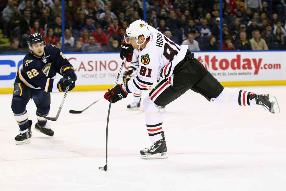 ST. LOUIS, MO - DECEMBER 3: Marian Hossa #81 of the Chicago Blackhawks scores a short-handed goal against the St. Louis Blues at the Scottrade Center  on December 3, 2011 in St. Louis, Missouri.  (Photo by Dilip Vishwanat/Getty Images)