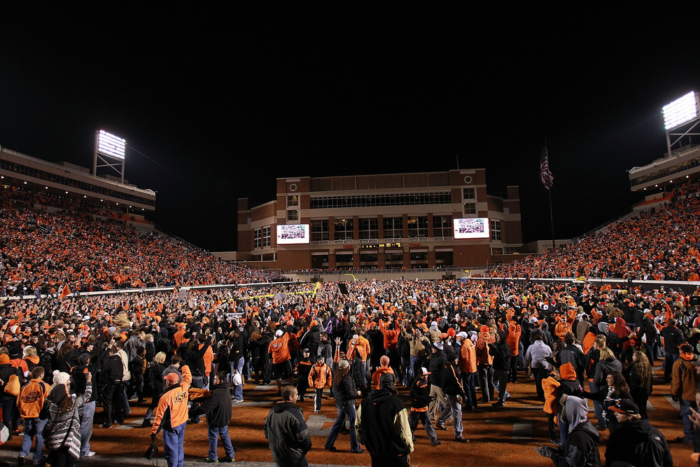 STILLWATER, OK - DECEMBER 03:  Oklahoma State Cowboys fans celebrate on the field after a 44-10 win against the Oklahoma Sooners at Boone Pickens Stadium on December 3, 2011 in Stillwater, Oklahoma.  (Photo by Ronald Martinez/Getty Images)