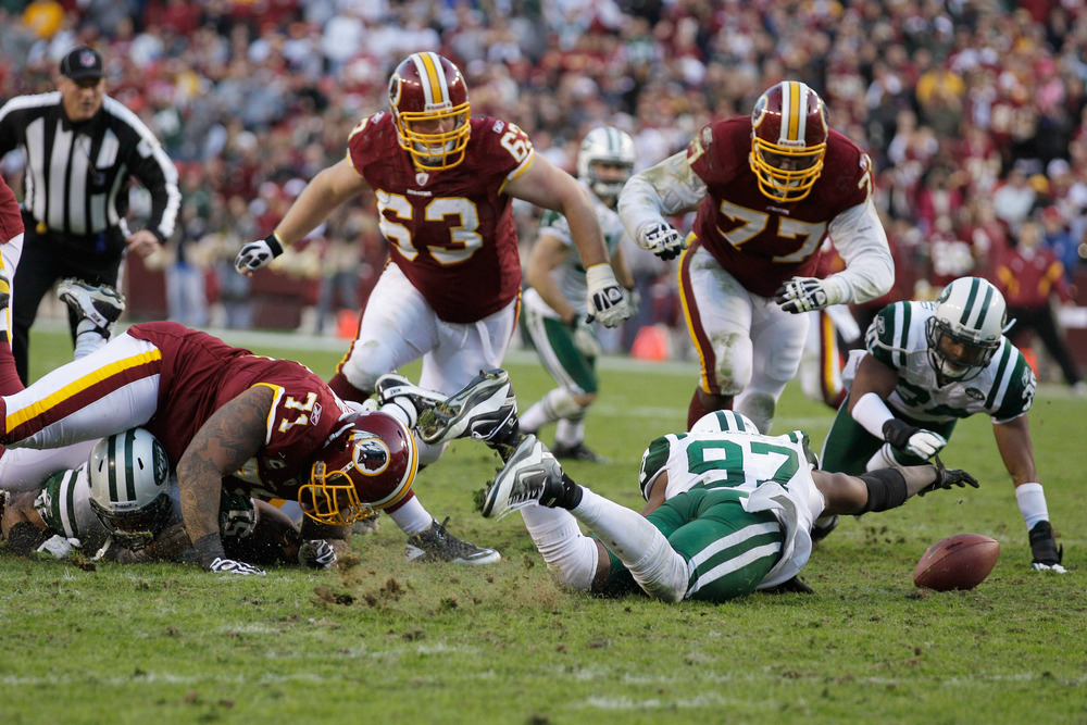 LANDOVER, MD - DECEMBER 04:  Calvin Pace #97 of the New York Jets recovers a Washington Redskins fumble during the second half at FedExField on December 4, 2011 in Landover, Maryland.  (Photo by Rob Carr/Getty Images)