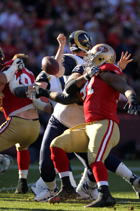 SAN FRANCISCO, CA - DECEMBER 04:  A.J. Feeley #4 of the St. Louis Rams fumbles the ball that was recovered by the San Francisco 49ers at Candlestick Park on December 4, 2011 in San Francisco, California.  (Photo by Ezra Shaw/Getty Images)