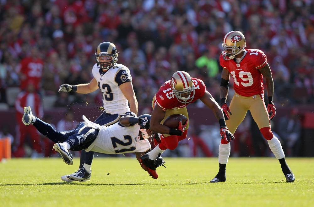 SAN FRANCISCO, CA - DECEMBER 04:  Michael Crabtree #15 of the San Francisco 49ers is tackled by Justin King #21 of the St. Louis Rams at Candlestick Park on December 4, 2011 in San Francisco, California.  (Photo by Ezra Shaw/Getty Images)