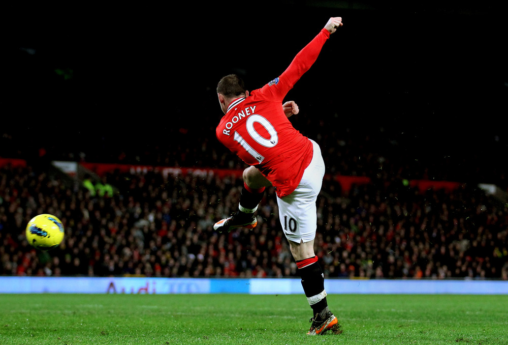 Wayne Rooney of Manchester United lashes a shot towards the Wolves goal during the Barclays Premier League match between Manchester United and Wolverhampton Wanderers at Old Trafford in Manchester, England.  (Photo by Alex Livesey/Getty Images)