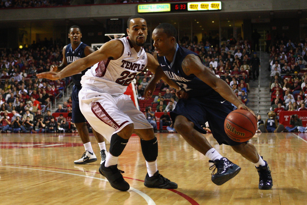PHILADELPHIA, PA - DECEMBER 10:  Maalik Wayns #2 of the Villanova Wildcats drives against Aaron Brown #22 of the Temple Owls at the Liacouras Center on December 10, 2011 in Philadelphia, Pennsylvania.  (Photo by Chris Chambers/Getty Images)