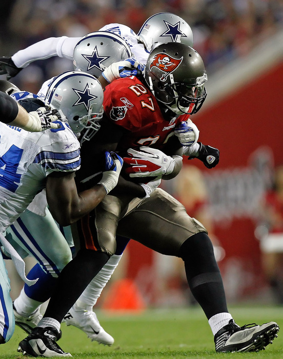 TAMPA, FL - DECEMBER 17:  Running back LeGarrette Blount #27 of the Tampa Bay Buccaneers runs the ball against the Dallas Cowboys during the game at Raymond James Stadium on December 17, 2011 in Tampa, Florida.  (Photo by J. Meric/Getty Images)