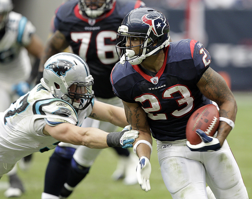 HOUSTON - DECEMBER 18:  Running back Arian Foster #23 of the Houston Texans rushes against the Carolina Panthers at Reliant Stadium on December 18, 2011 in Houston, Texas.  (Photo by Bob Levey/Getty Images)