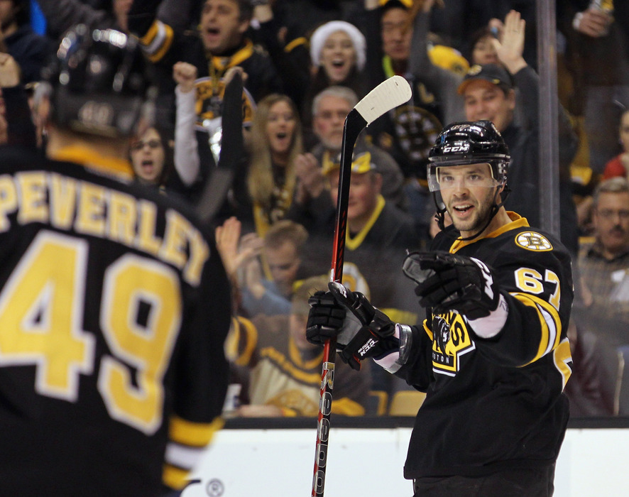 BOSTON, MA - DECEMBER 19:  Benoit Pouliot #67 of the Boston Bruins celebrates his goal at 12:13 of the first period against the Montreal Canadiens at the TD Garden on December 19, 2011 in Boston, Massachusetts.  (Photo by Bruce Bennett/Getty Images)