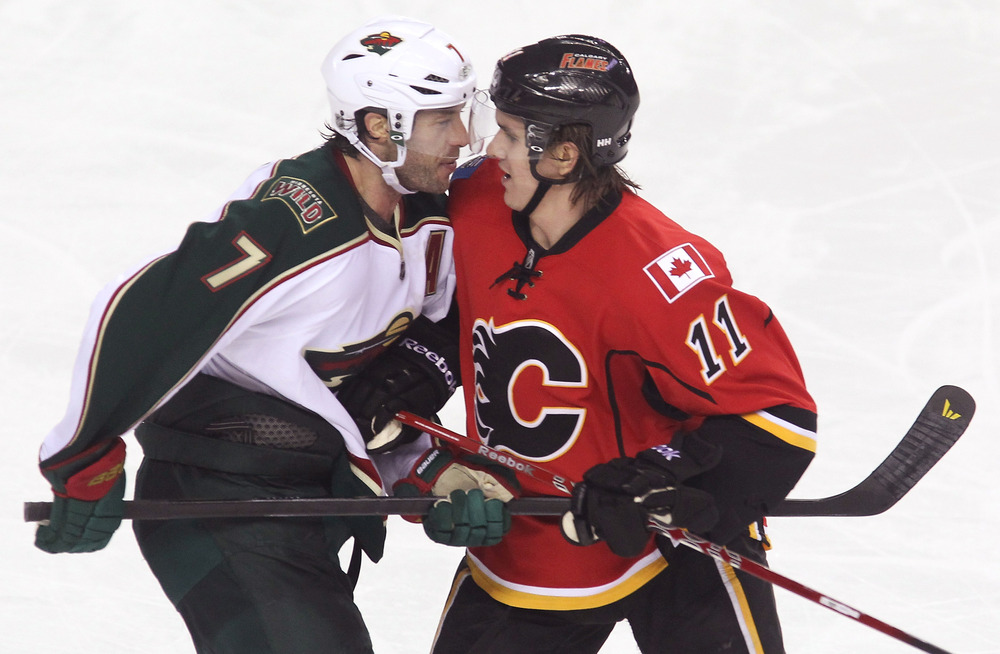 Potential Sharks trade targets Matt Cullen and Mikael Backlund look longingly into each other's eyes.