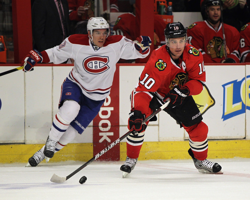 CHICAGO, IL - DECEMBER 21: Patrick Sharp #10 of the Chicago Blackhawks looks to pass in front of Michael Cammalleri #13 of the Montreal Canadiens at the United Center on December 21, 2011 in Chicago, Illinois. (Photo by Jonathan Daniel/Getty Images)