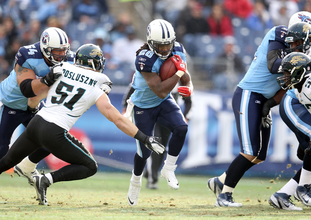 NASHVILLE, TN - DECEMBER 24:  Chris Johnson #28 of the Tennessee Titans runs with the ball during the NFL game against the Jacksonville Jaguars at LP Field on December 24, 2011 in Nashville, Tennessee.  (Photo by Andy Lyons/Getty Images)