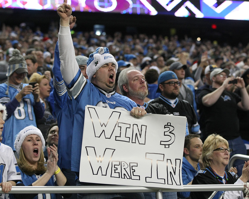 DETROIT, MI - DECEMBER 24: A Lions fan holds his sign and screams during a NFL game between the San Diego Chargers and the Detroit Lions at Ford Field on December 24, 2011 in Detroit, Michigan.  (Photo by Dave Reginek/Getty Images)