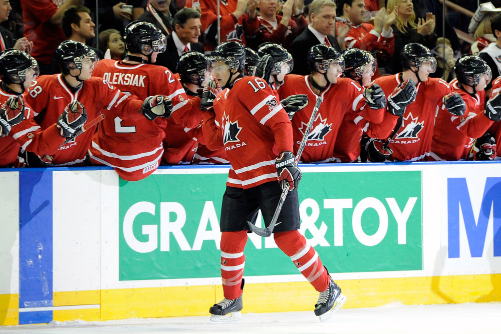 """Mark Stone is congratulated by Team Canada after he tells them he """"has a good feeling"""" that he'll be playing in the NHL playoffs in a few months."""