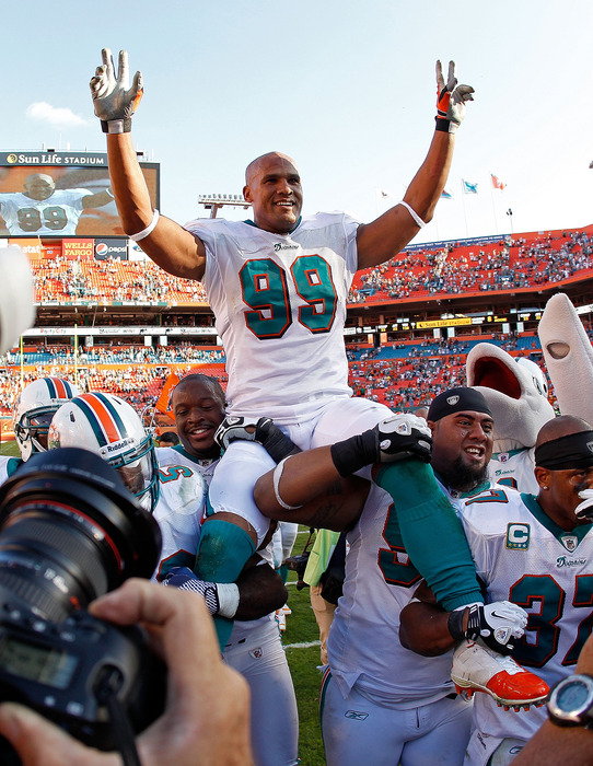 MIAMI GARDENS, FL - JANUARY 01:  Jason Taylor #99 of the Miami Dolphins is carried off the field after his final game against the New York Jets at Sun Life Stadium on January 1, 2012 in Miami Gardens, Florida.  (Photo by Mike Ehrmann/Getty Images)