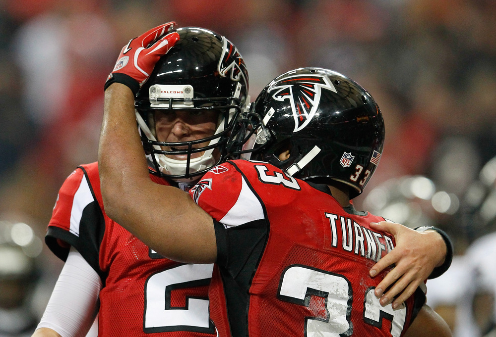 ATLANTA, GA - JANUARY 01:  Michael Turner #33 of the Atlanta Falcons celebrates his touchdown against the Tampa Bay Buccaneers with Matt Ryan #2 at Georgia Dome on January 1, 2012 in Atlanta, Georgia.  (Photo by Kevin C. Cox/Getty Images)