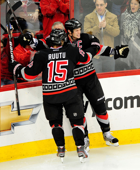 RALEIGH, NC - JANUARY 06:  Eric Staal celebrates his luck finally turning around. Tuomo Ruutu is there to tell him that he had no such problems. (Photo by Grant Halverson/Getty Images)