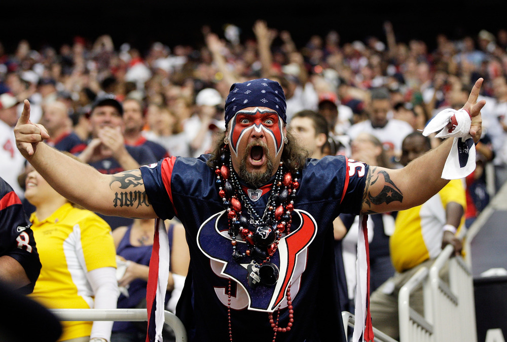 HOUSTON, TX - JANUARY 07:  A Houston Texans fan cheers during the AFC Wildcard Playoff game against the Cincinnati Bengals on January 7, 2012 at Reliant Stadium in Houston, Texas.  (Photo by Jamie Squire/Getty Images)
