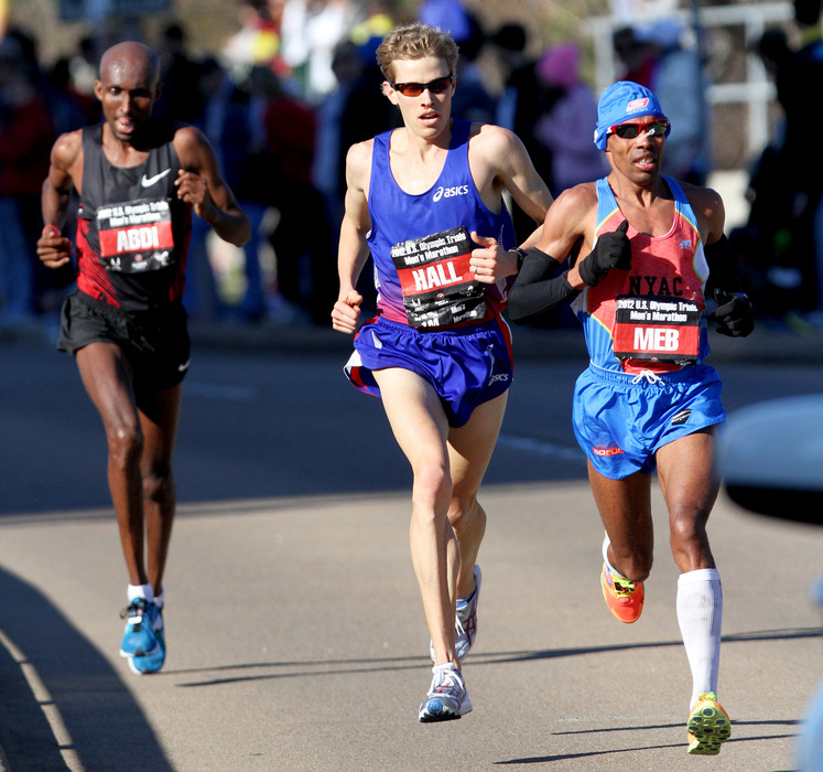 HOUSTON, TX - JANUARY 14: (L-R) Meb Keflezighi, Ryan Hall and Abdi Abdirahman compete in the U.S. Marathon Olympic Trials January 14, 2012 in Houston, Texas. (Photo by Thomas B. Shea/Getty Images)