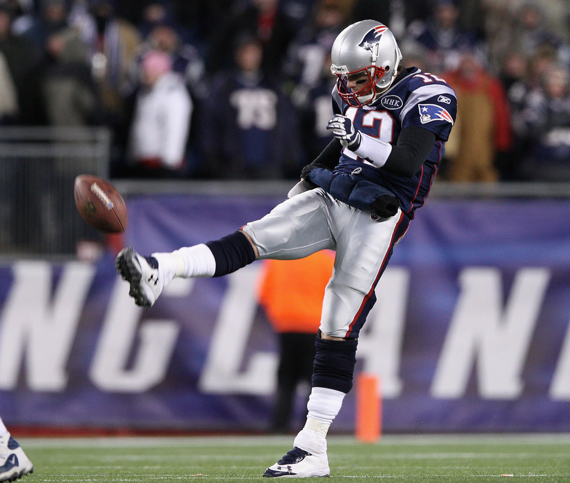 FOXBORO, MA - JANUARY 14:  Tom Brady #12 of the New England Patriots punts against the Denver Broncos during their AFC Divisional Playoff Game at Gillette Stadium on January 14, 2012 in Foxboro, Massachusetts.  (Photo by Elsa/Getty Images)