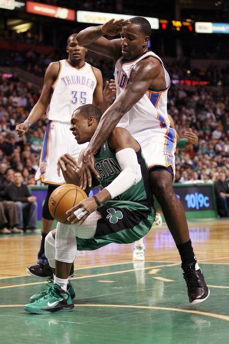 Kendrick Perkins #5 of the Oklahoma City Thunder fouls Rajon Rondo #9 of the Boston Celtics on January 16, 2012 at TD Garden in Boston, Massachusetts.  (Photo by Elsa/Getty Images)