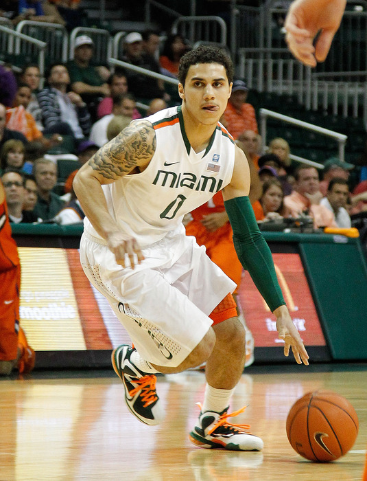 CORAL GABLES, FL - JANUARY 18:  Shane Larkin #0 of the Miami (Fl) Hurricanes drives to the basket during a game against the Clemson Tigers on January 18, 2012 in Coral Gables, Florida.  (Photo by Mike Ehrmann/Getty Images)