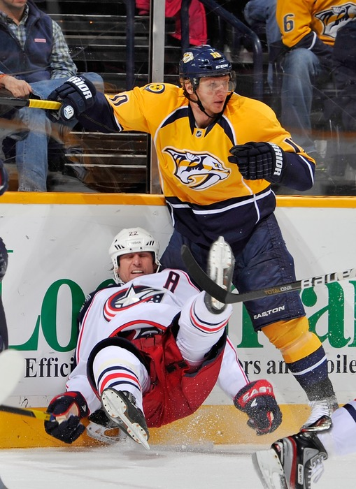 NASHVILLE, TN - JANUARY 23:  Vinny Prospal #22 of the Columbus Blue Jackets is held by Martin Erat #10 of the Nashville Predators at the Bridgestone Arena on January 23, 2012 in Nashville, Tennessee.  (Photo by Frederick Breedon/Getty Images)