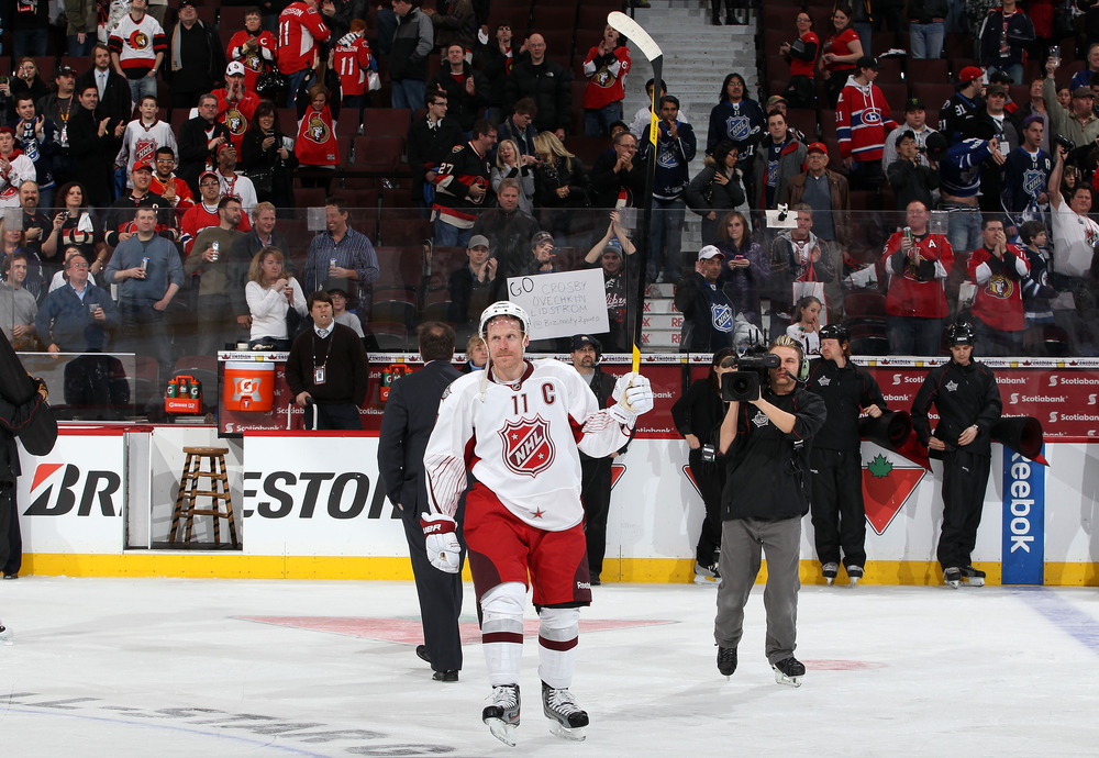 Alfie and the fans salute each other at the NHL All-Star game. (Photo by Christian Petersen/Getty Images)