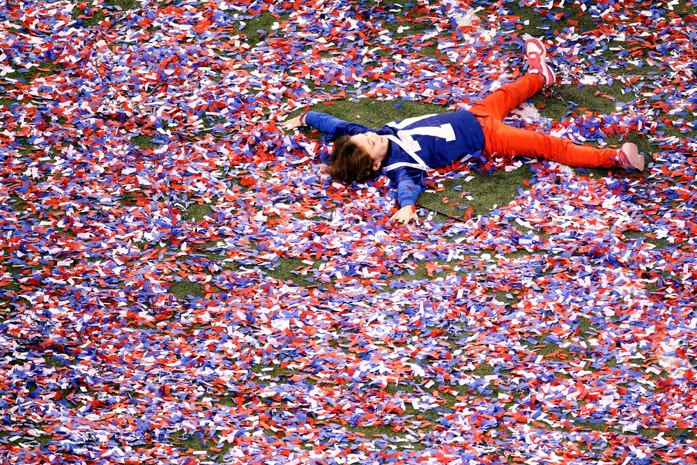 INDIANAPOLIS, IN - FEBRUARY 05:  A young fan plays in the confetti after Super Bowl XLVI at Lucas Oil Stadium on February 5, 2012 in Indianapolis, Indiana.  (Photo by Gregory Shamus/Getty Images)