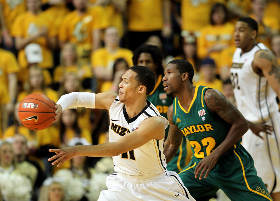 COLUMBIA, MO - FEBRUARY 11:  Michael Dixon #11 of the Missouri Tigerspasses as AJ Walton #22 of the Baylor Bears defends during the game on February 11, 2012  at Mizzou Arena in Columbia, Missouri.  (Photo by Jamie Squire/Getty Images)