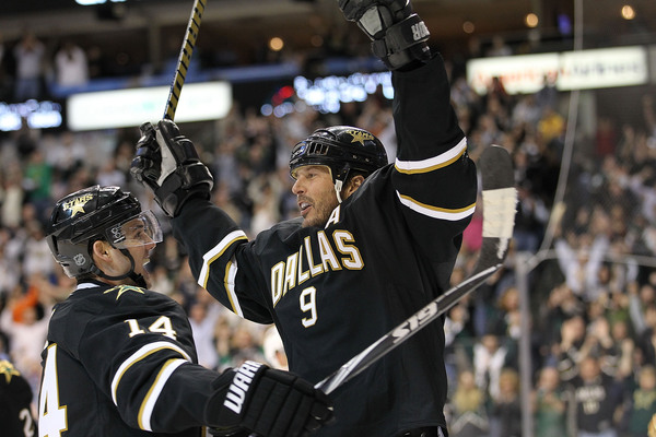 DALLAS - APRIL 08:  Center Mike Modano #9 of the Dallas Stars celebrates his goal with Jamie Benn #14 against the Anaheim Ducks at American Airlines Center on April 8, 2010 in Dallas, Texas.  (Photo by Ronald Martinez/Getty Images)
