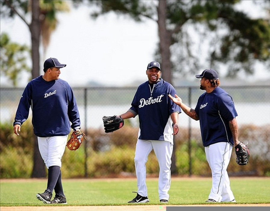 Feb 21, 2012; Lakeland, FL, USA; Detroit Tigers third baseman Miguel Cabrera (left) talks with teammates Delmon Young (middle) and Prince Fielder during spring training at Joker Merchant Stadium. Mandatory Credit: Andrew Weber-US PRESSWIRE
