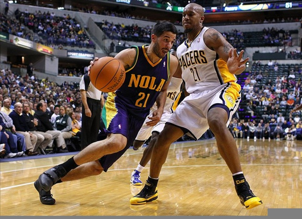 Feb. 21, 2012; Indianapolis, IN, USA; New Orleans Hornets point guard Greivis Vasquez (21) dribbles the ball around Indiana Pacers power forward David West (21) at Bankers Life Fieldhouse. Mandatory credit: Michael Hickey-US PRESSWIRE