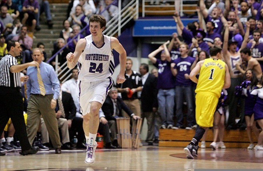 Feb 21, 2012; Evanston, IL, USA; Northwestern Wildcats forward John Shurna (24) reacts after hitting a three-point shot during the first half against the Michigan Wolverines at Welsh-Ryan Arena. Mandatory Credit: Tommy Giglio-US PRESSWIRE
