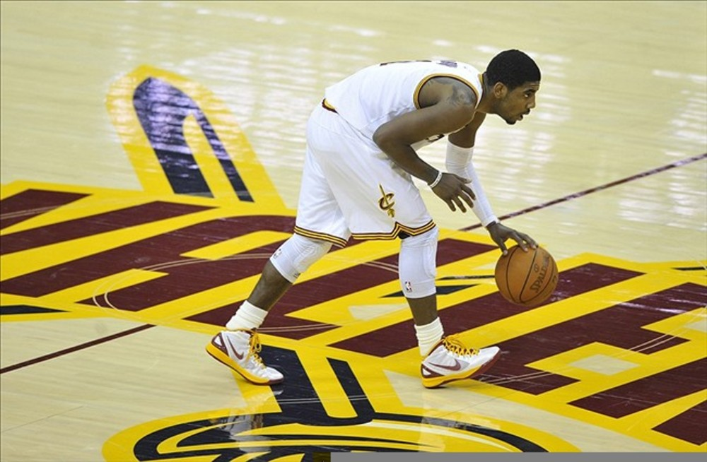 Feb 121, 2012; Cleveland, OH, USA; Cleveland Cavaliers point guard Kyrie Irving (2) dribbles the ball over the center line in the fourth quarter against the Detroit Pistons at Quicken Loans Arena. Mandatory Credit: David Richard-US PRESSWIRE