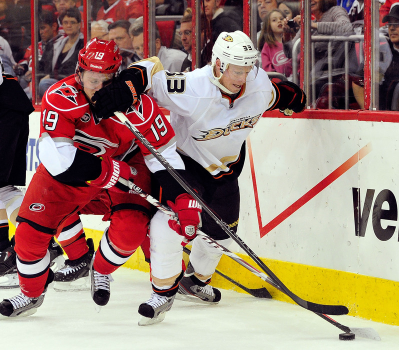 RALEIGH, NC - FEBRUARY 23:  Jason Blake #33 of the Anaheim Ducks battles for the puck with Jiri Tlusty #19 of the Carolina Hurricanes at the RBC Center on February 23, 2012 in Raleigh, North Carolina.  (Photo by Grant Halverson/Getty Images)