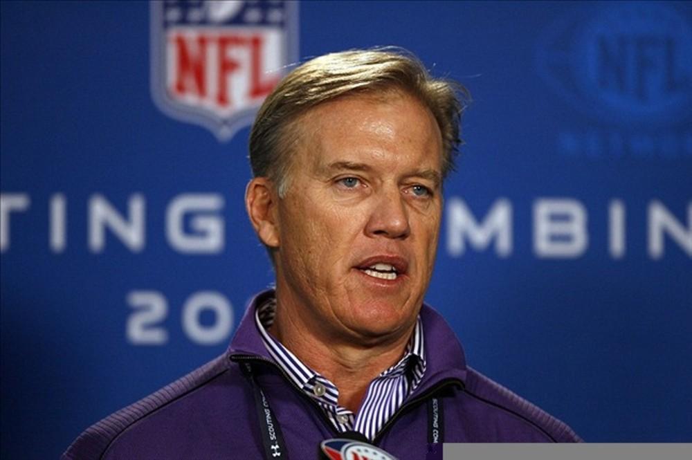 Denver Broncos CFO John Elway speaks at a press conference. Mandatory Credit: Brian Spurlock-US PRESSWIRE