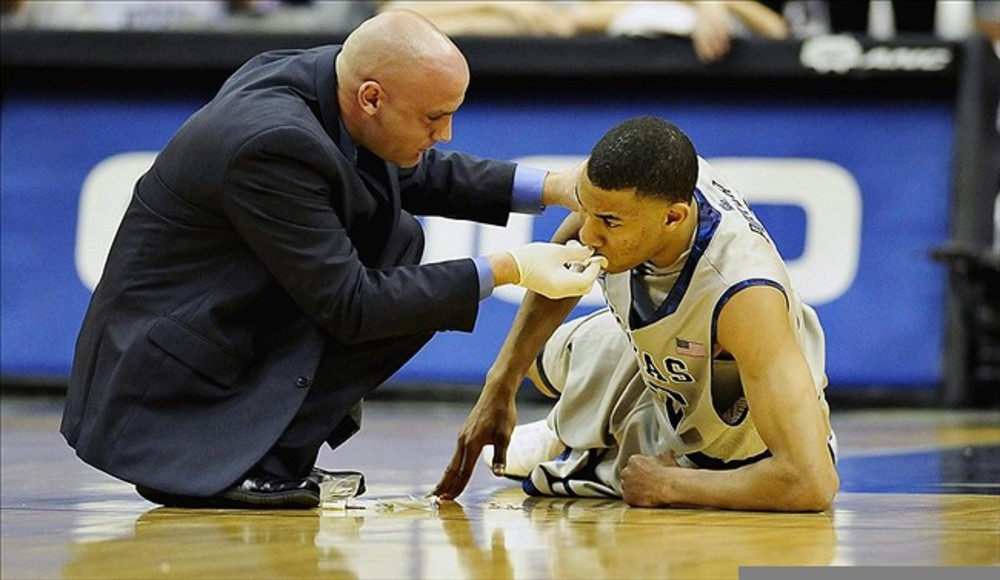 Feb 25, 2012; Washington D.C., USA; Georgetown Hoyas forward Otto Porter (22) gets tended to after being hit in the mouth in the first half against the Villanova Wildcats at Verizon Center. Mandatory Credit: Evan Habeeb-US PRESSWIRE